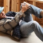 a man on a construction site who has fallen and injured himself