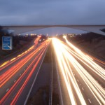 A long exposure picture of cars on the motorway at dusk